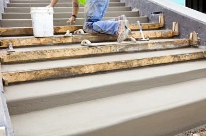 AAP Construction mason building cement steps.